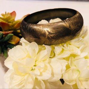 Gold floral metal bangle